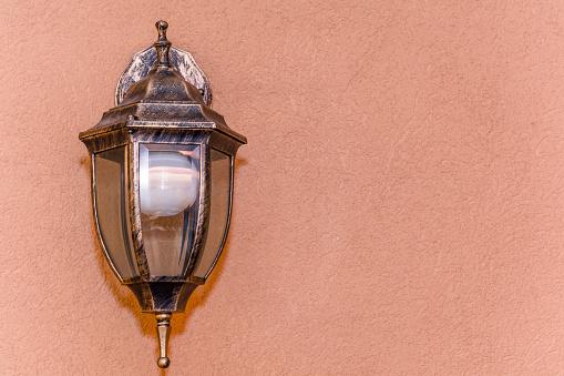 Old beautiful lantern an orange nice wall