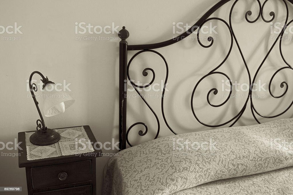 Old Bed with Lamp stock photo
