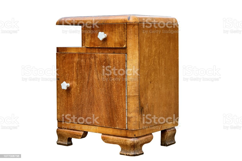 Old bedside table in mid-century style isolated on white background. Bedroom furniture stock photo