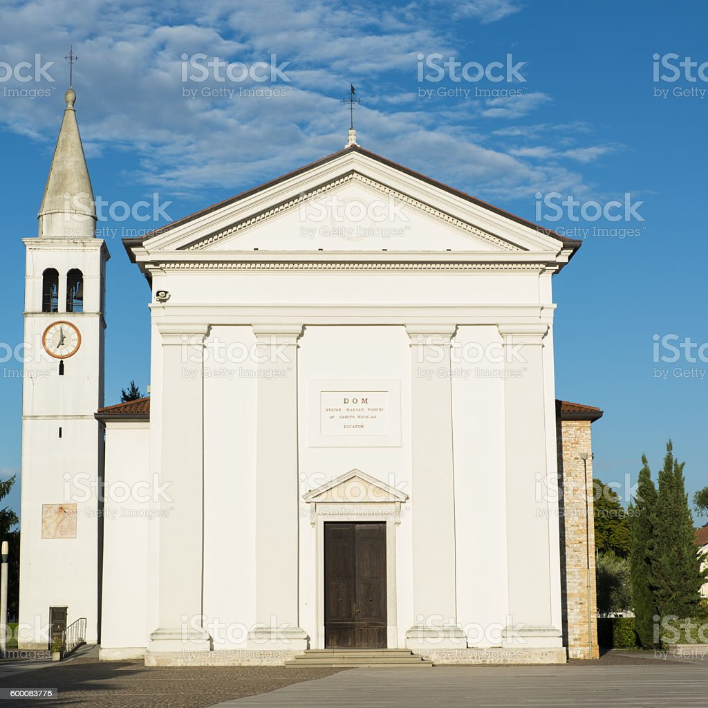 Old bell tower in the central square Fiume Veneto stock photo