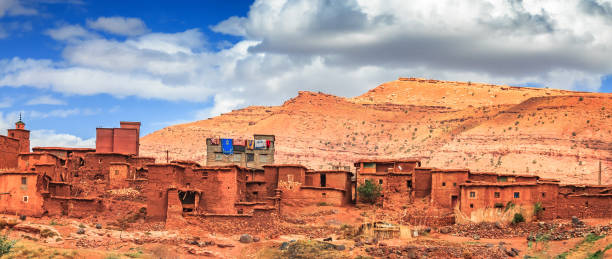 old berber architecture in high atlas mountains region in morocco. houses of clay at the foot of the mountains. - desolated stock pictures, royalty-free photos & images