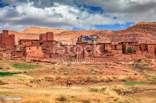 istock Old berber architecture in High Atlas Mountains region in Morocco. Houses of clay at the foot of the mountains. 1096578080