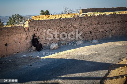 istock Old berber man seated 1294318696