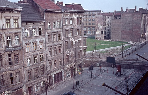 Berlin (West), Germany, 1964. Old Berlin street, with even war-drawn tenements  and the Berlin Wall, just three years old.