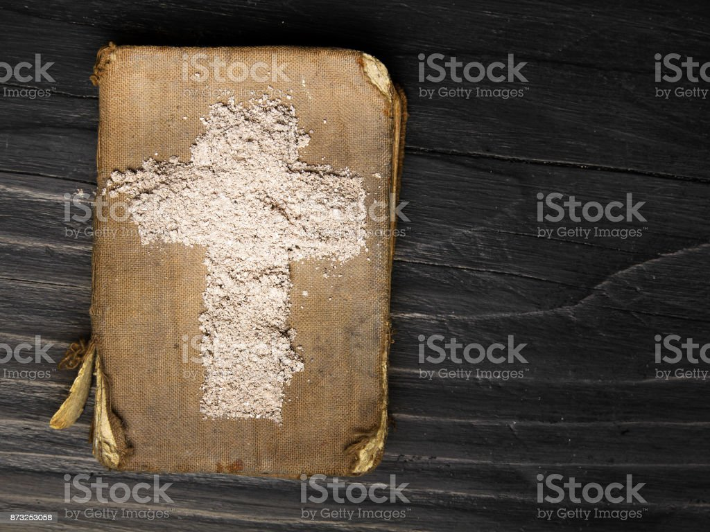 Old bible and cross of ash symbols of ash wednesday stock photo old bible and cross of ash symbols of ash wednesday royalty free stock biocorpaavc
