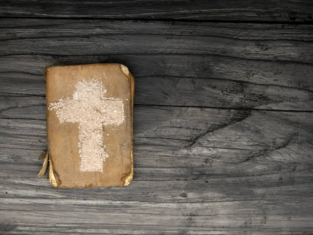old bible and cross of ash - symbols of ash wednesday. - ash cross stock photos and pictures