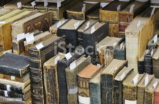Old Bible Books on a bookshelf from the 1800s