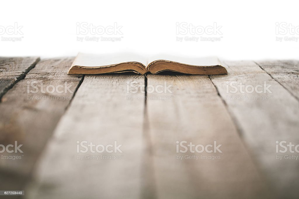 Old bible on a wooden table stock photo