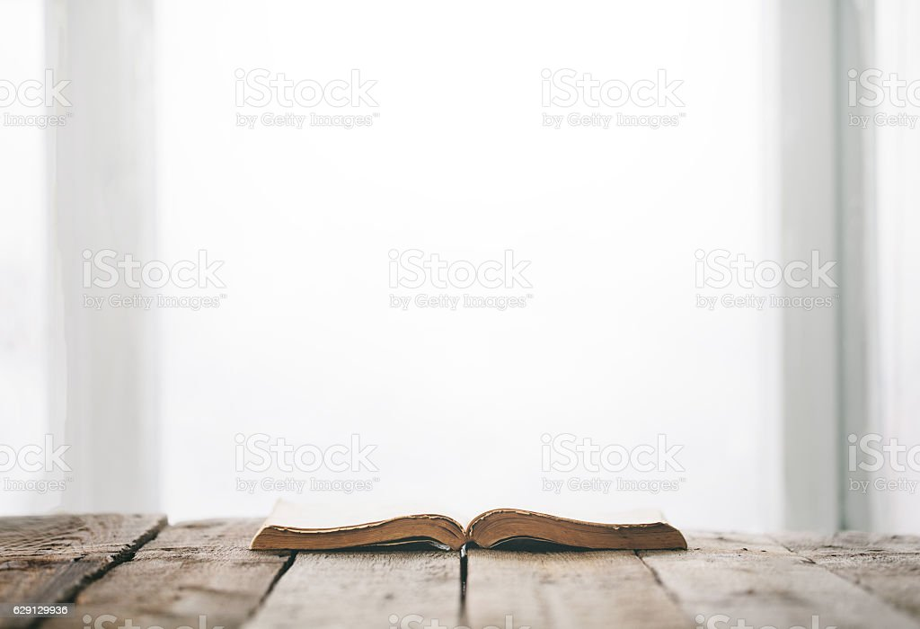 Old bible on a wooden table - foto stock