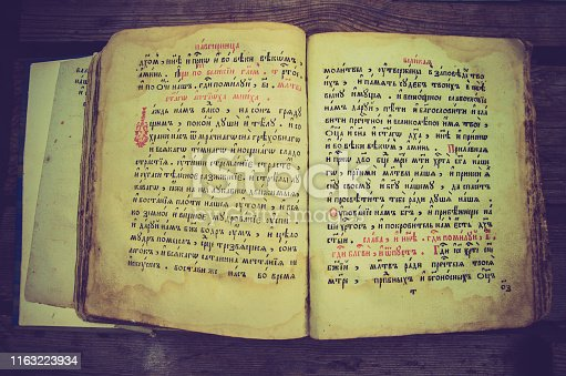 old slavic bible with cyrillic text