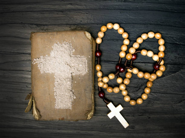 old bible, rosary and cross of ash - ash wednesday. - ash cross stock photos and pictures