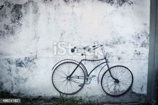Old bicycle against wall