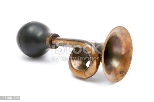 Old-fashioned brass horn isolated on a white background.