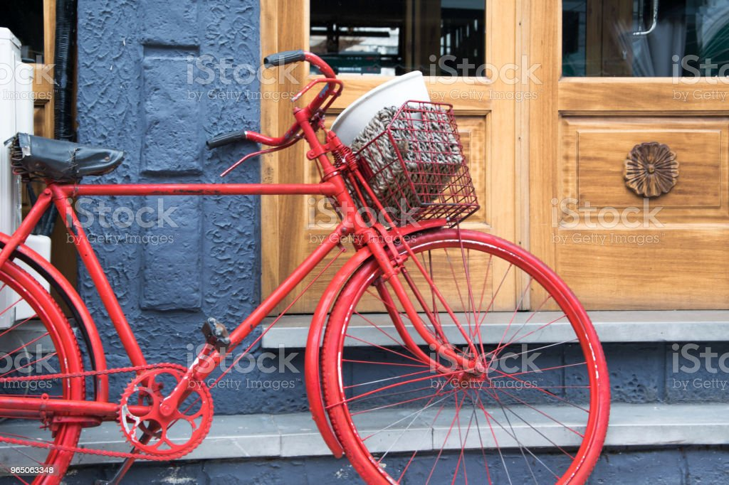 Old bicycle in front of the house door, traditional mode of transportation for healthy life royalty-free stock photo