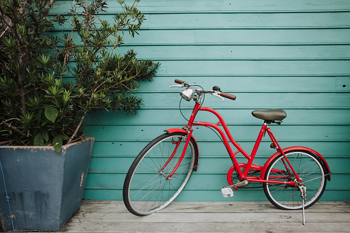 Old bicycle on wooden background