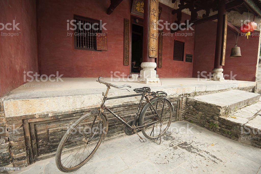 Old bicycle parked in front of an ancient temple, China royalty-free stock photo