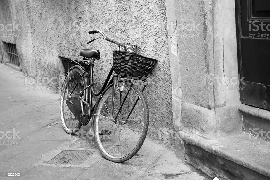 Old bicycle parked on street black and white royalty-free stock photo