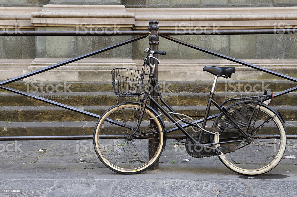 Old bicycle tied to a fence royalty-free stock photo