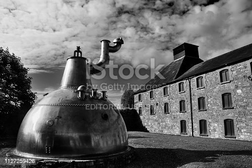 Cork, Ireland - June 20, 2008:  Old big copper whiskey distillery on stone foundation at the Jameson Heritage Centre  in Midleton Co. Cork, 12 miles east of Cork City on the main Cork Waterford Road.