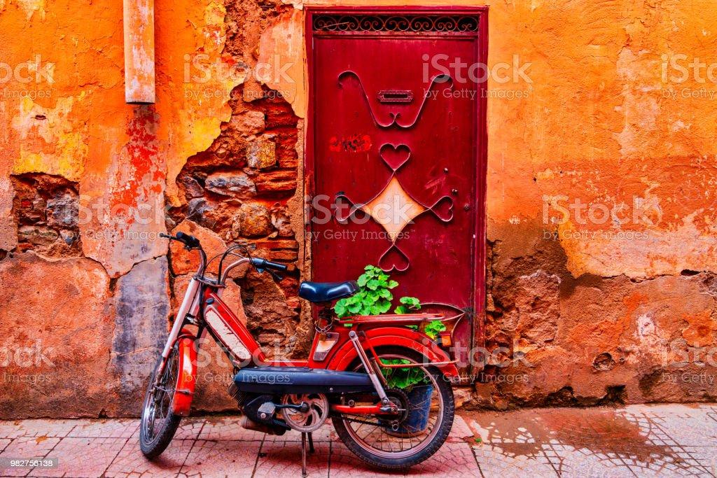 Old bike in Medina district of Marrakech, Morocco stock photo
