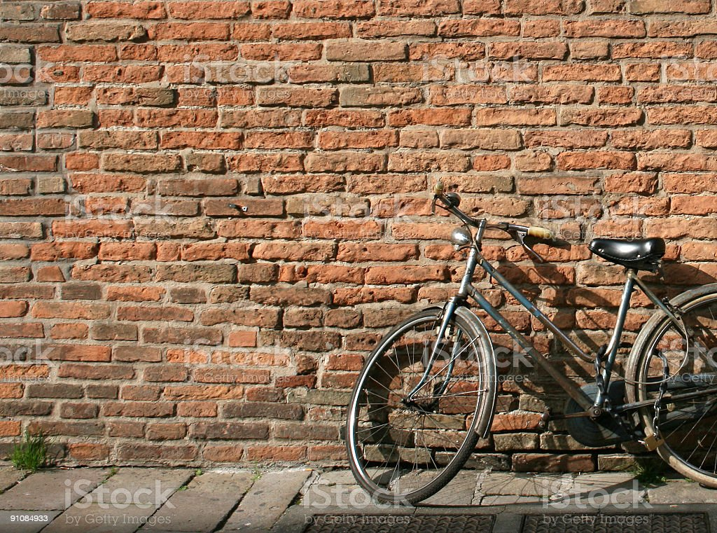 Old bike leaning on wall royalty-free stock photo