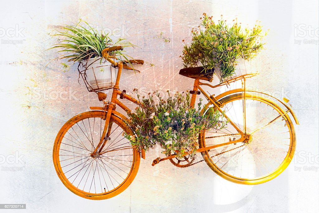 Old bike with floral decoration. Retro picture stock photo