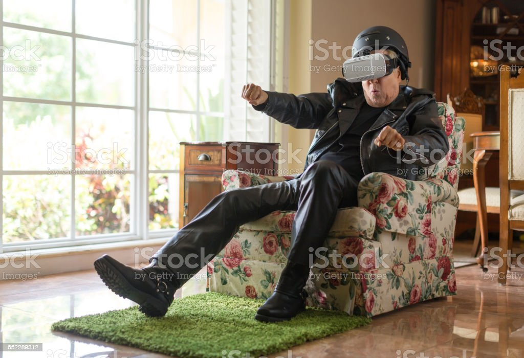 Old biker using virtual reality stock photo