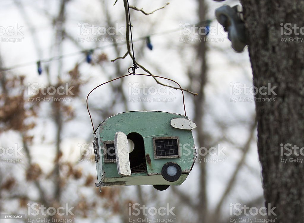 Old Birdhouse Shaped Like a Camper stock photo