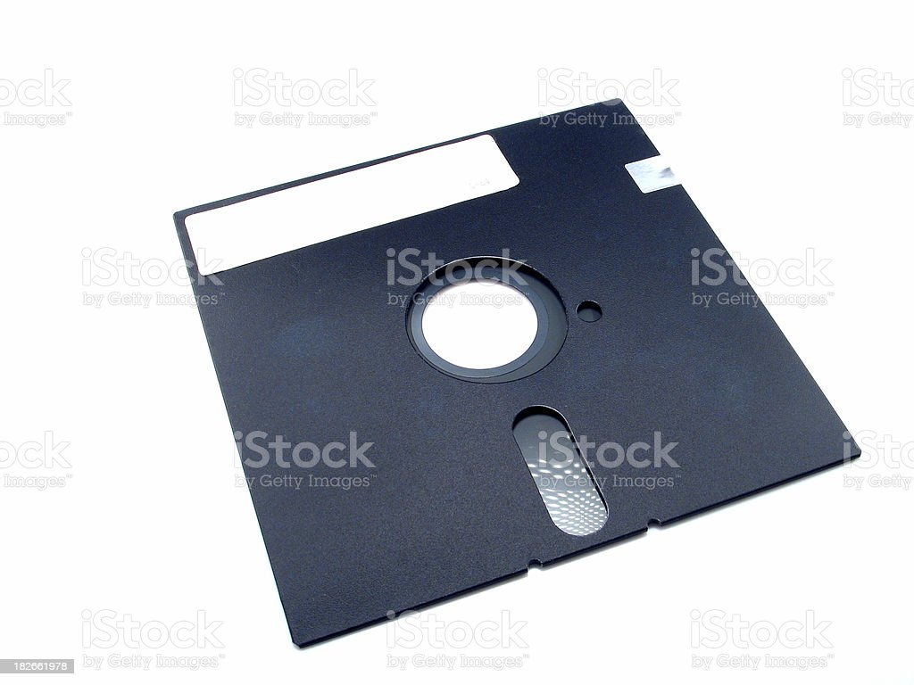 A old, black 5 inch floppy disk royalty-free stock photo