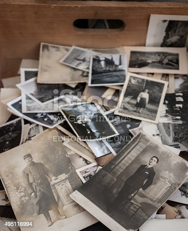 478384809 istock photo Old black and white and sepia photos at flea market. 495116994