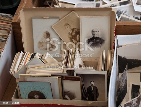 478384809 istock photo Old black and white and sepia photos at flea market. 495117008