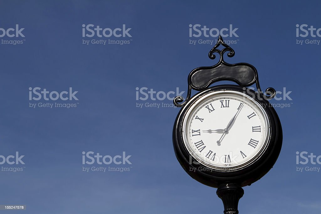 Old Black and White Street Clock with Roman Numerals Outdoors stock photo