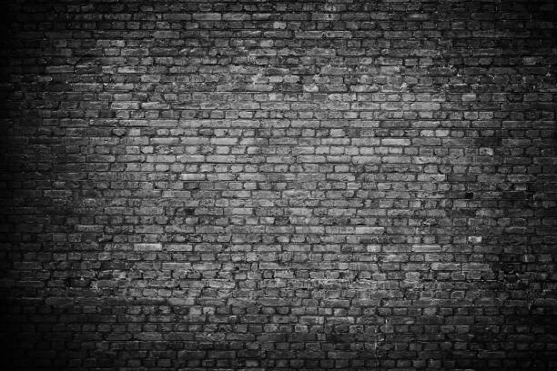 Old black brick wall background. stock photo