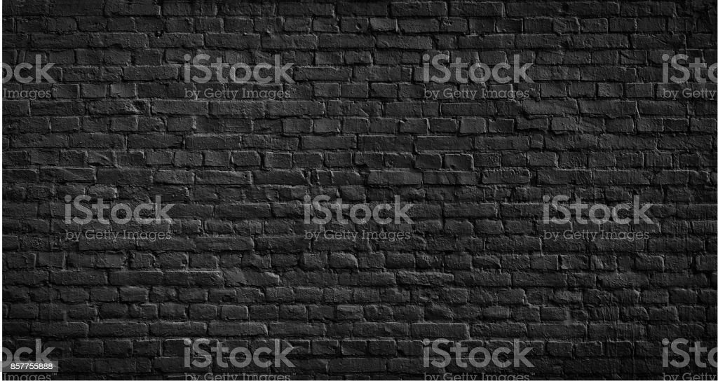 Old black brick wall background. stock photo