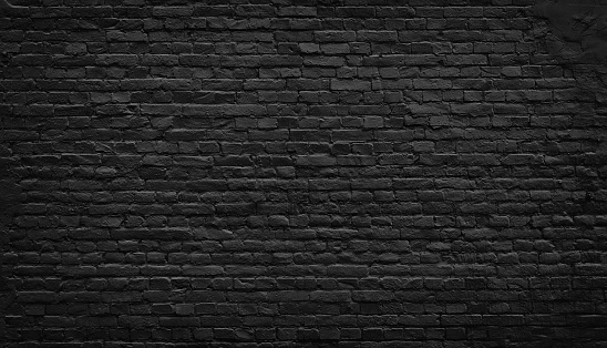 istock Old black brick wall background. 869404968