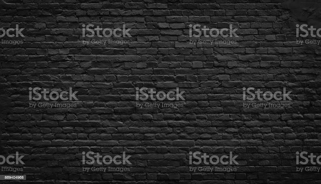 Old black brick wall background. - foto stock