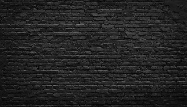old black brick wall background. - wall foto e immagini stock