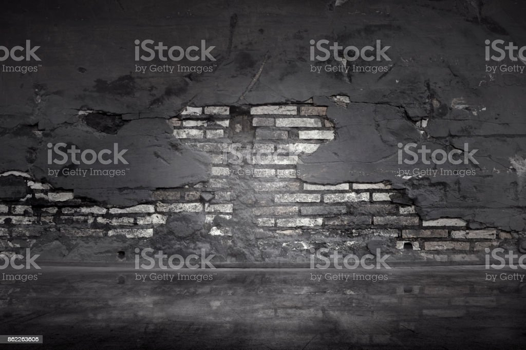 Old black brick wall stock photo