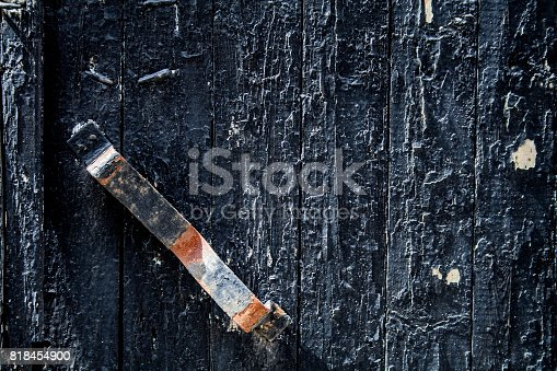 894368086 istock photo old black door with rusty handle. background, vintage. 818454900