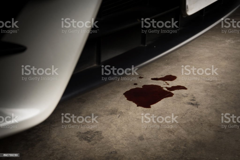 Old black oil used of car auto mobile leak and drop on concrete floor , check and maintenance service stock photo