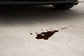 Old black oil used of car auto mobile leak and drop on concrete floor , check and maintenance service