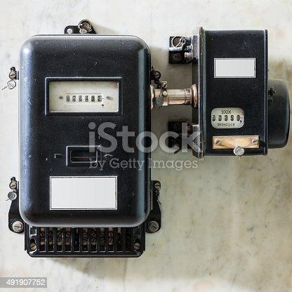 old black plumbed power meter at wall