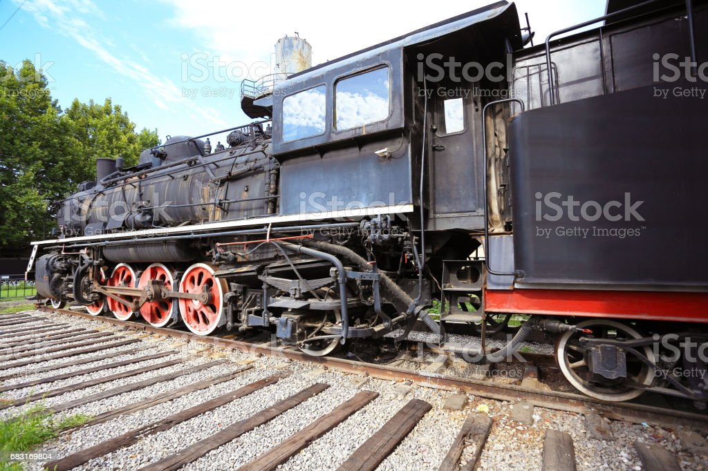 Old black steam train locomotive of partial close up Lizenzfreies stock-foto