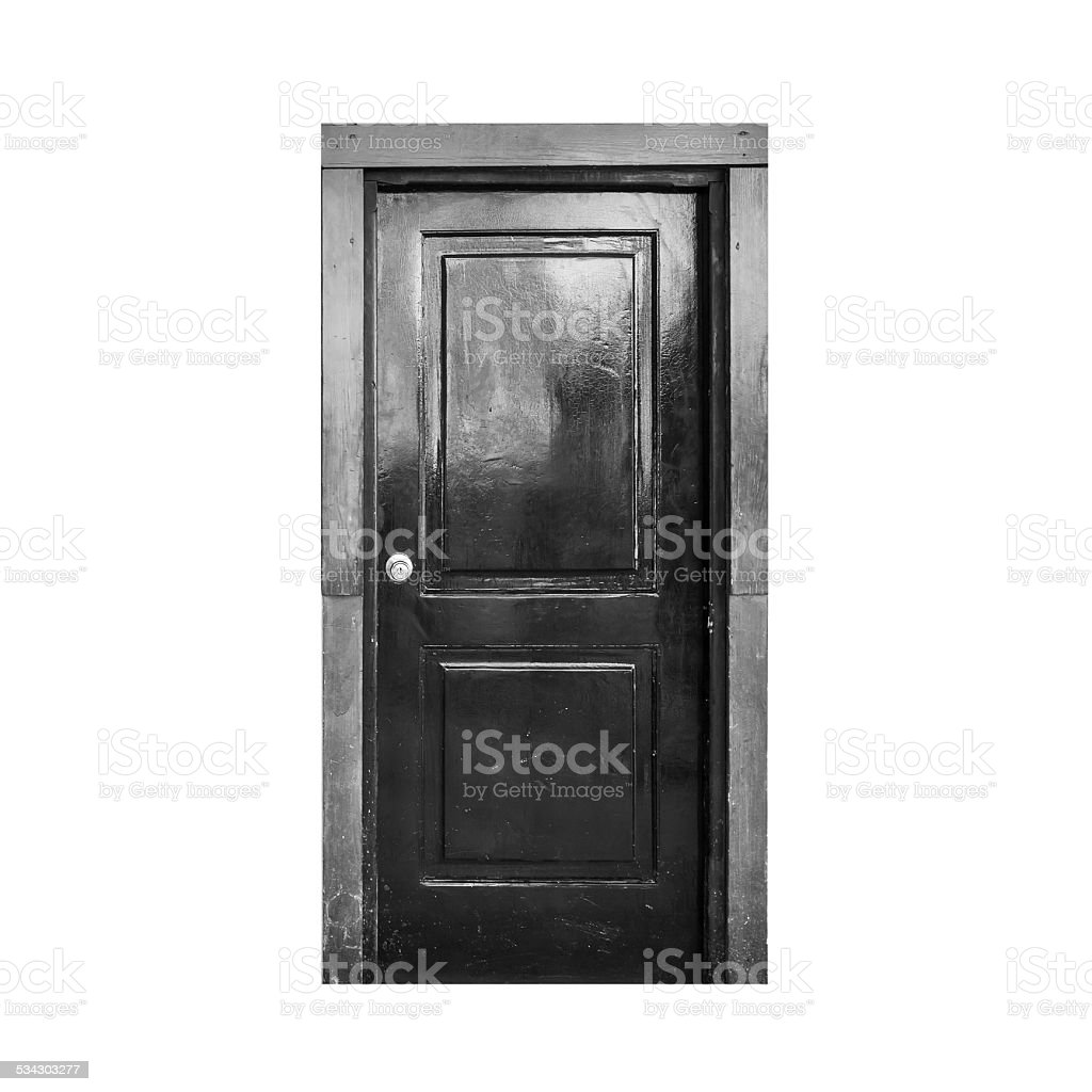 Old black wooden door isolated on white stock photo