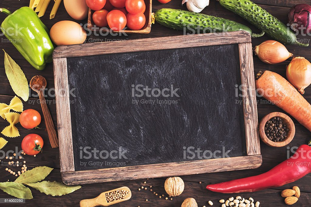 Old blackboard and cooking ingredients stock photo