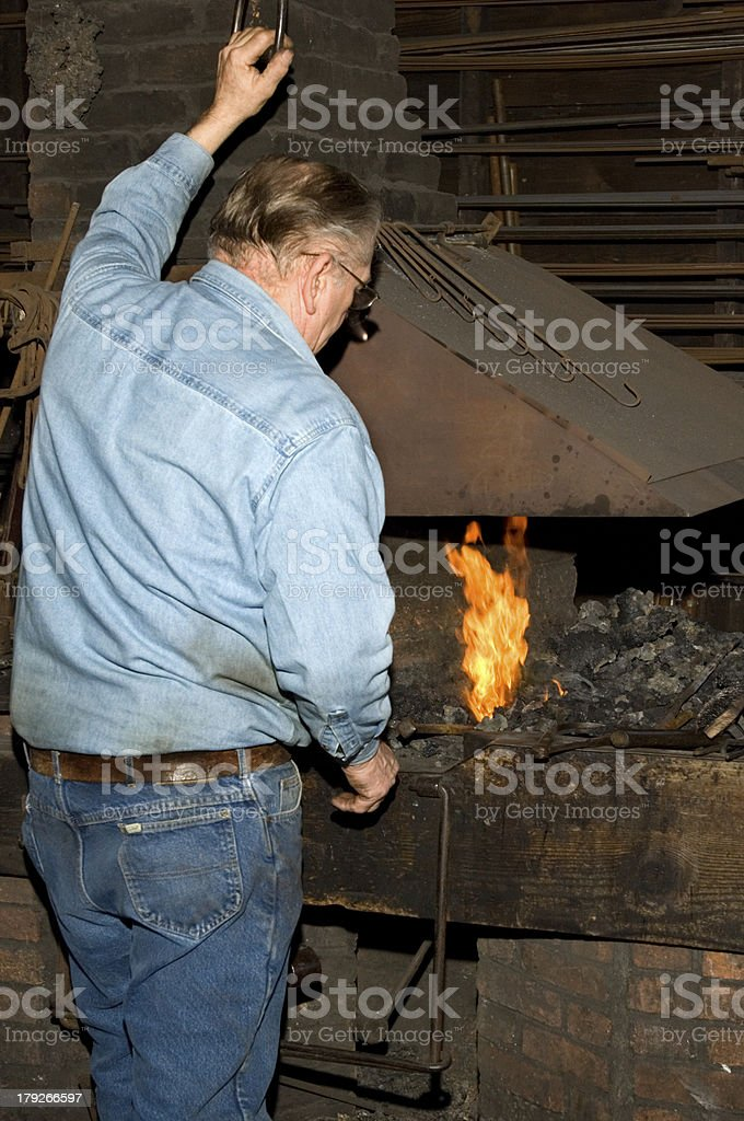 Old Blacksmith at the Forge royalty-free stock photo