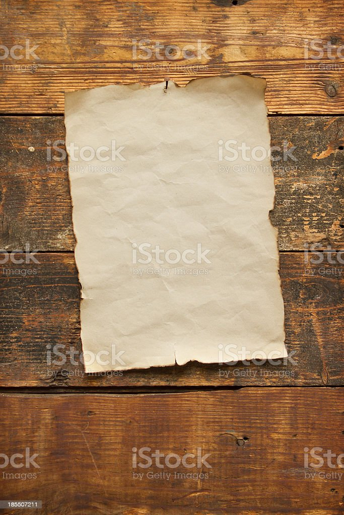 old blank paper nailed to a plank door royalty-free stock photo