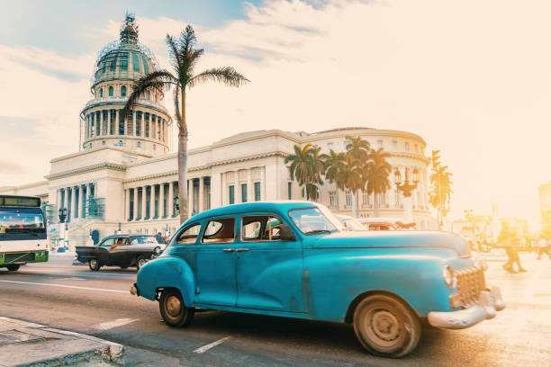 old blue american car in front of capitol in havanna - cuba stock photos and pictures