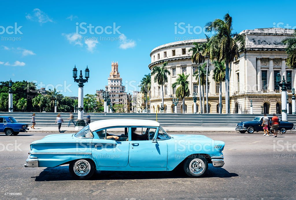 Old blue American car on Havana street, near Capitolio stock photo