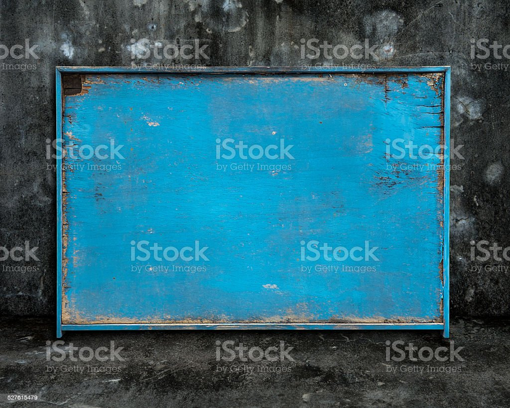 old blue blank weathered wooden board on dark mottled background stock photo